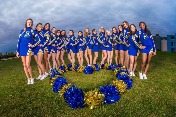 UAF cheerleaders pose in front of the SRC on the Fairbanks campus.